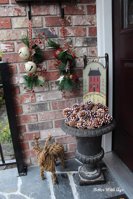 Front porch with reindeer, pinecones, and bells.