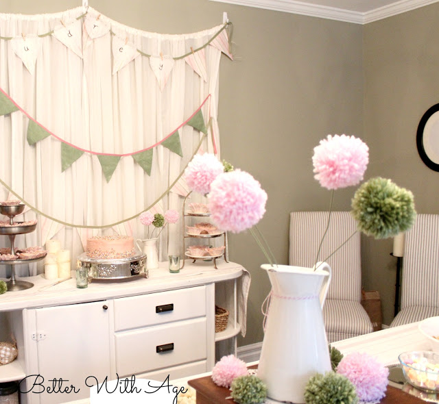 Party curtains and pompom flowers / decorated party room - So Much Better With Age