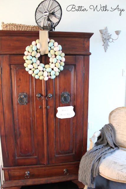 Hello spring / Easter egg wreath hanging on armoire - So Much Better With Age