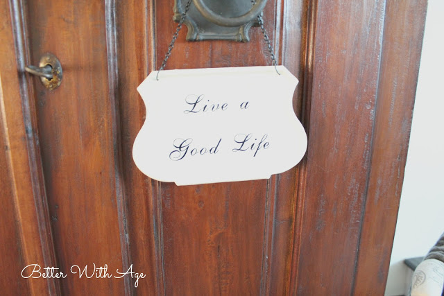 Hello spring / Live a good life sign on armoire door - So Much Better With Age