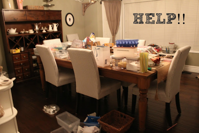 Pantry Reveal With Lots of Tips / pantry items on dining table - So Much Better With Age