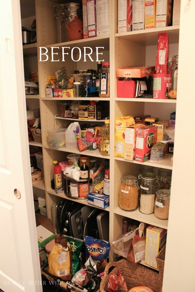 A before picture of the pantry with boxes of food items and baking sheets all cluttered together.