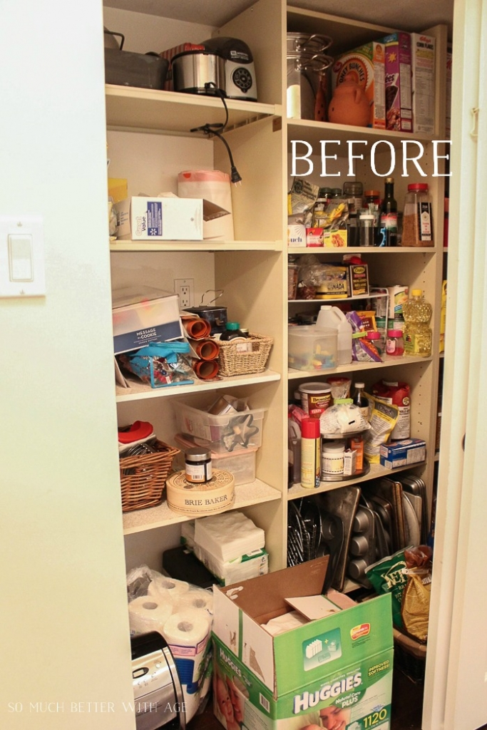 A pantry with multiple shelves cluttered with food items.
