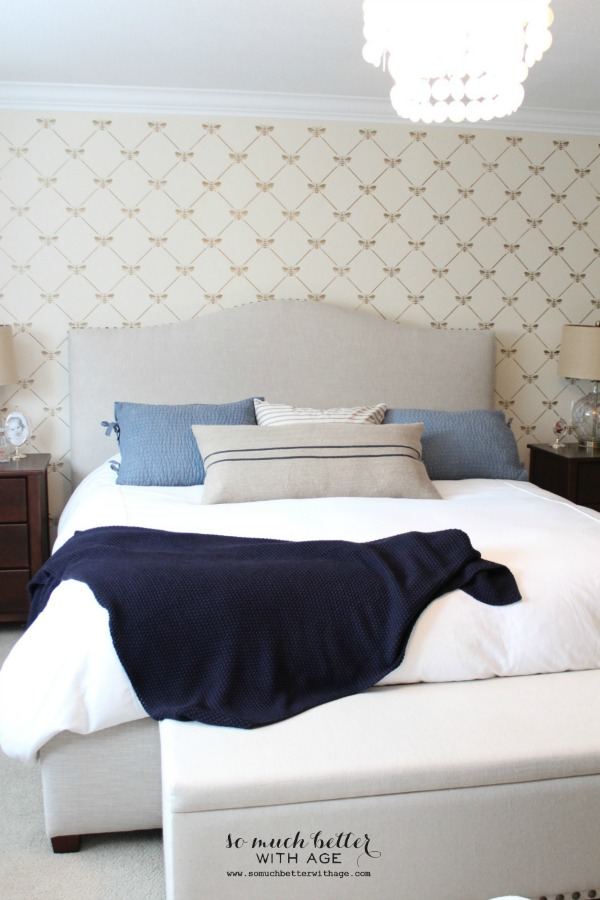 Blue & white master bedroom with stencilled bee wall