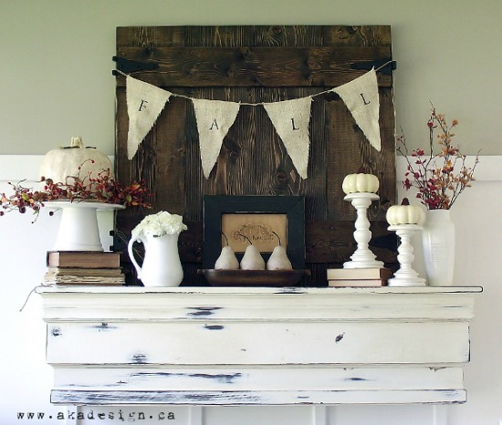 Rustic wood panel with fall banner on a wooden shelf.