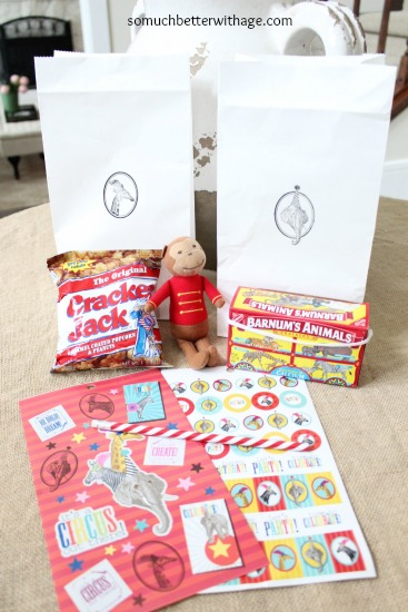 Treat bags on table with cute stuffed monkey.