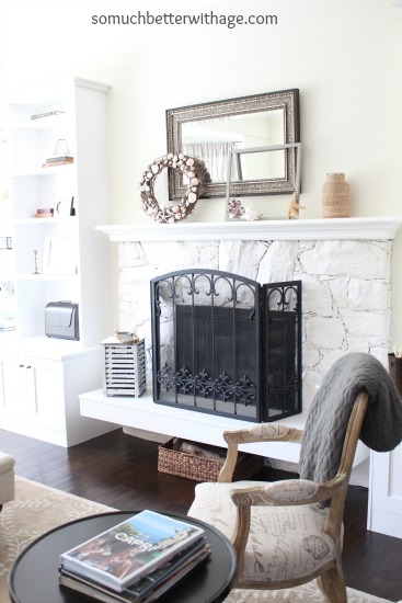 Easy Summer Mantel Update / living room with chair and blanket on chair - So Much Better With Age