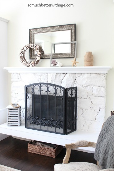 Easy Summer Mantel Update / fireplace mantel with wreath and mirror above it - So Much Better With Age