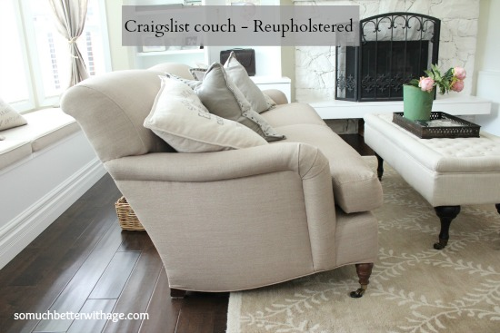 Reupholstered couch in a neutral color in the living room.