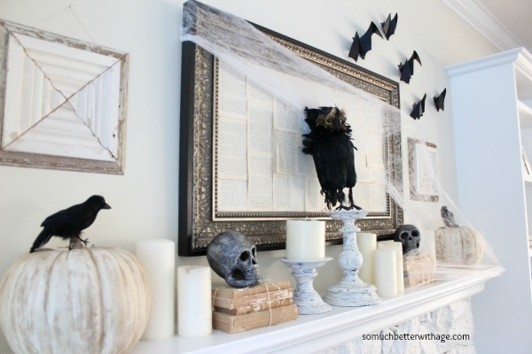 Black owl on mantel with candles.
