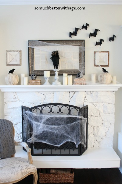 White fireplace with bats on the wall.