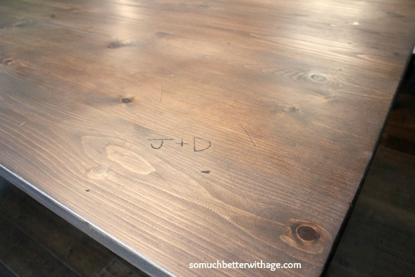 Initials carved in table www.somuchbetterwithage.com