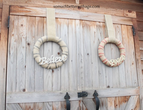 Wooden fence with wreaths on them.