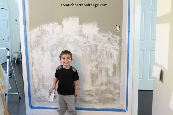 my son helping me paint www.somuchbetterwithage.com