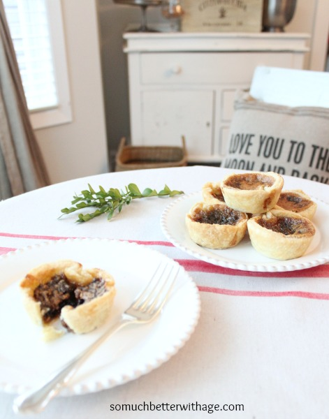 Best butter tart recipe ever / tarts on plate with sprig of green - So Much Better With Age