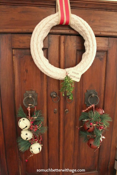 No sew wreath using sleeves of an old sweater / wreath hanging on door - So Much Better With Age