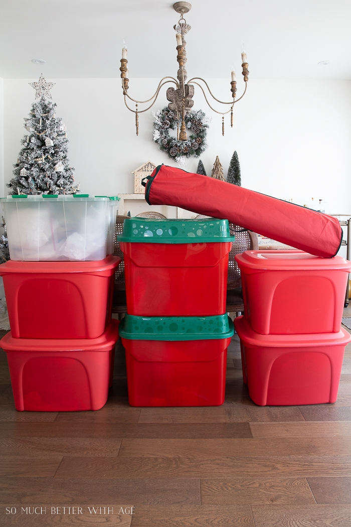 Red storage bins for Christmas ornaments and decor.