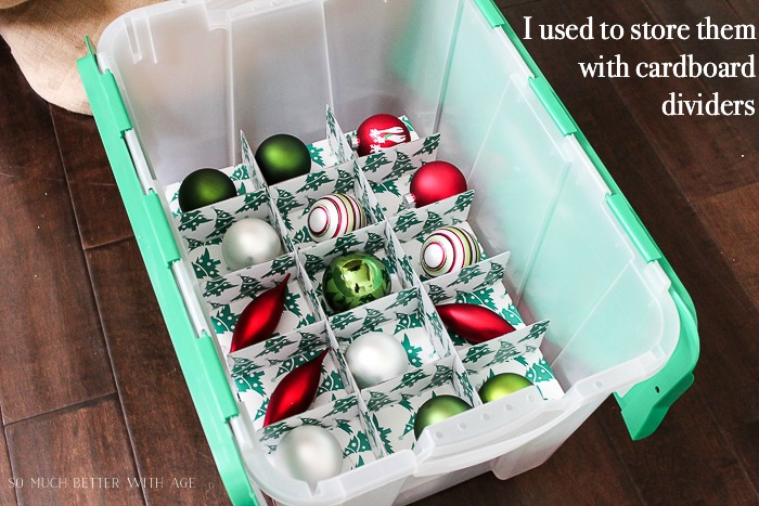Christmas ornaments in storage bin with dividers.