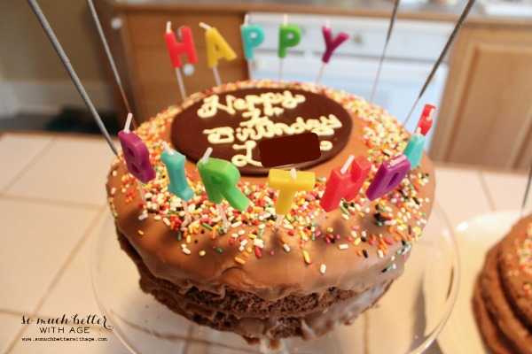 A chocolate sprinkled birthday cake.