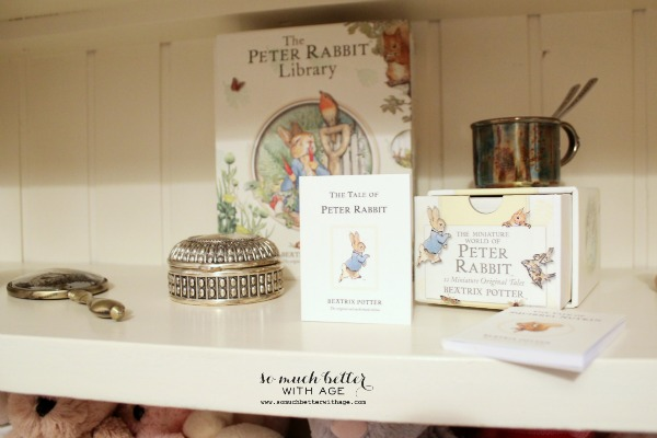 Silver baby mirror, cup and Peter Rabbit books.