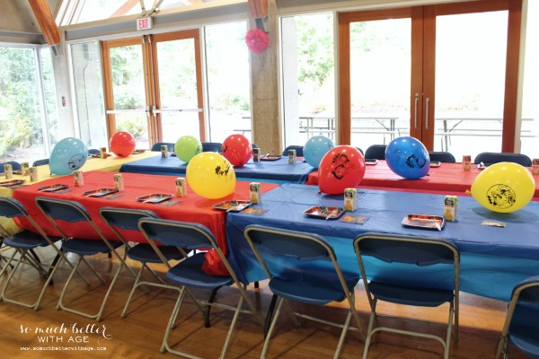 Red and blue table covers in party room.