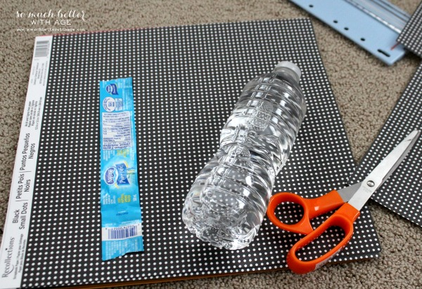 Water bottle, and labels and scissors on floor.