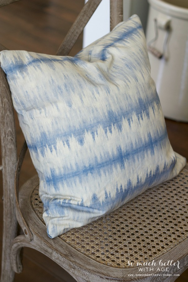 Blue ikat fabric / Envelope pillow cover tutorial via somuchbetterwithage.com
