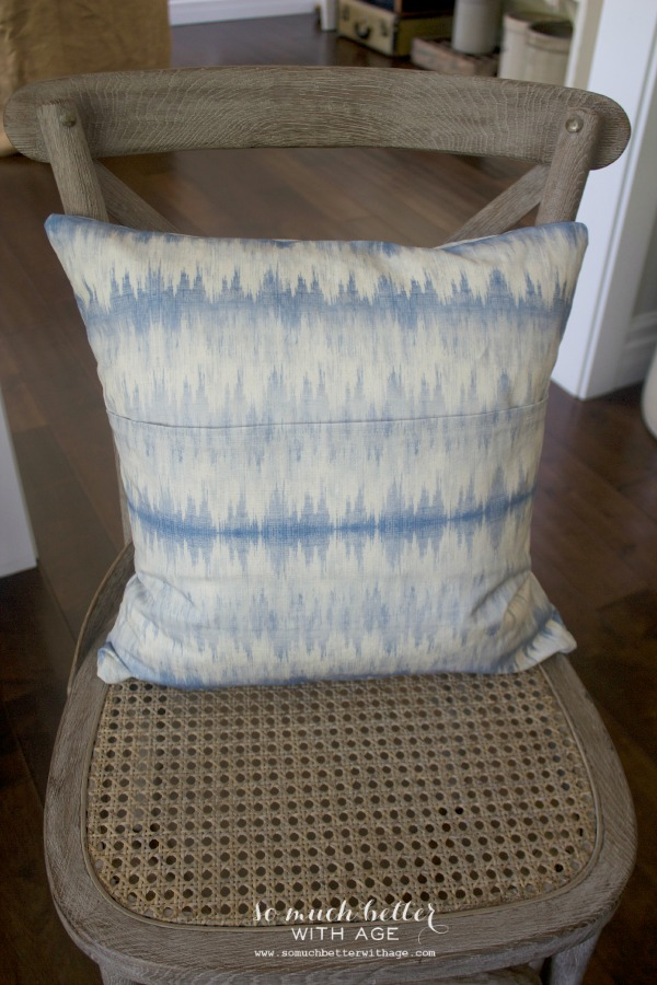 Ikat blue fabric / Envelope pillow cover tutorial via somuchbetterwithage.com