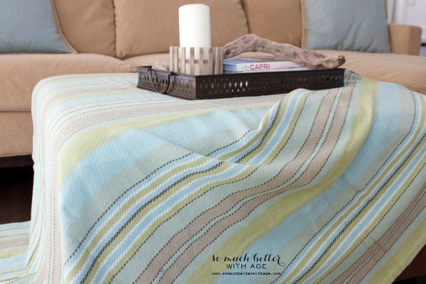 Striped blanket / Adding color to the family room via somuchbetterwithage.com