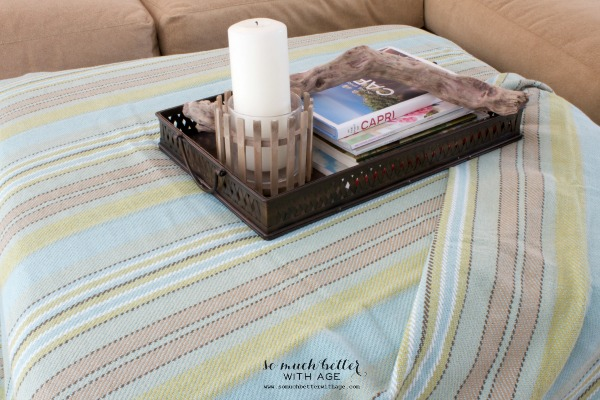 Striped throw / Adding color to the family room via somuchbetterwithage.com