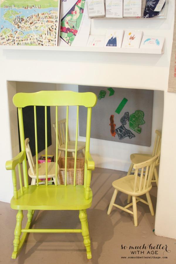 Yellow child's rocking chair.