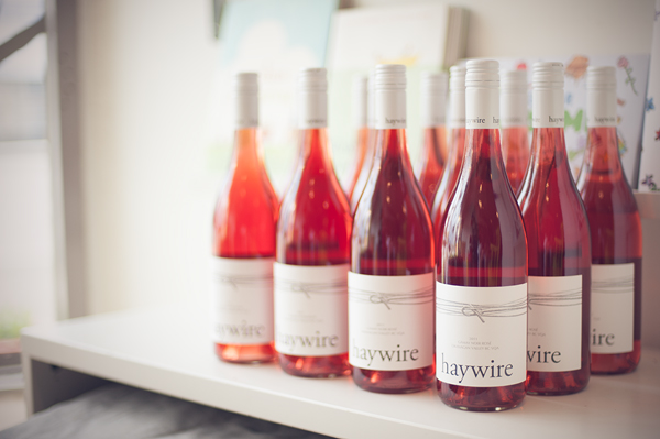 Bottles of Haywire rose wine on counter.