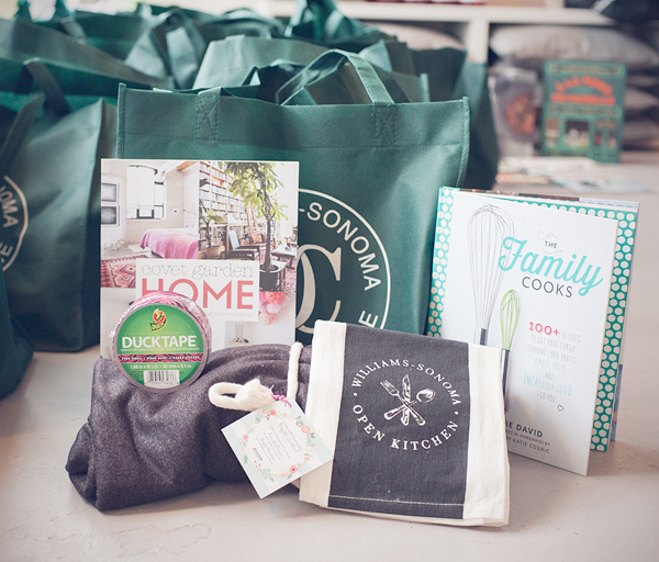 Green tote bag filled with cookbooks and other presents.