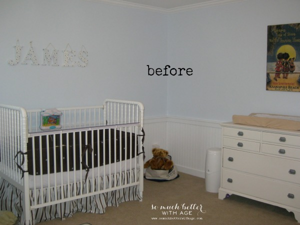 White crib in boys bedroom with a white dresser.