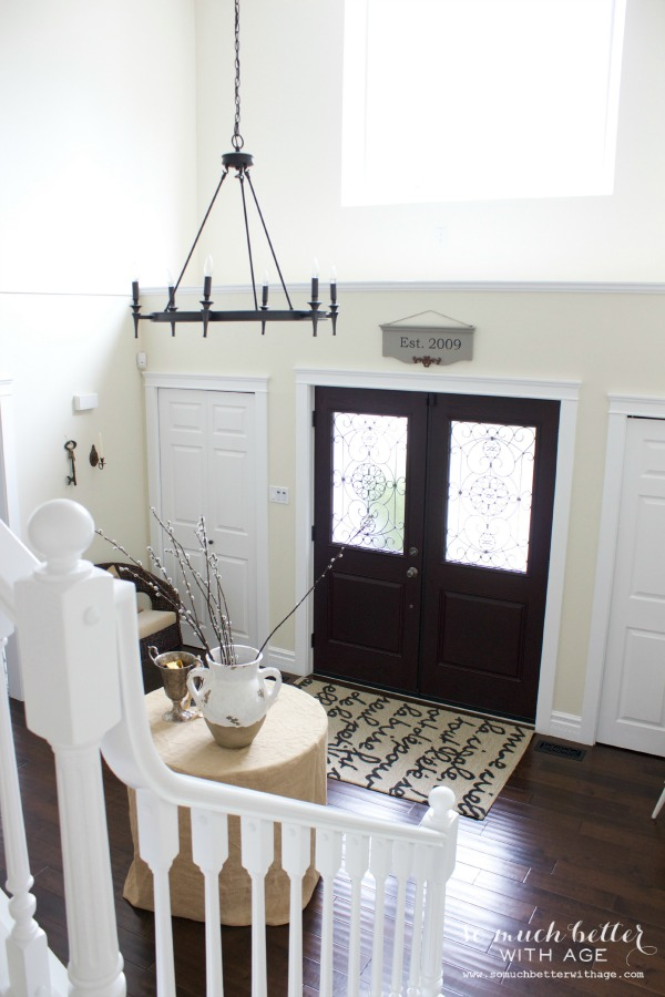 The front door and foyer in neutral colors.