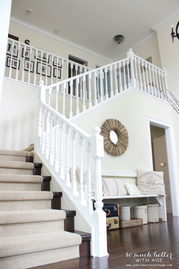 White staircase leading to the upstairs of house.