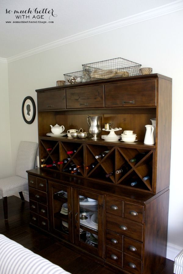 Should I paint the interior of this cabinet like Ballard Designs cabinets? via somuchbetterwithage.com