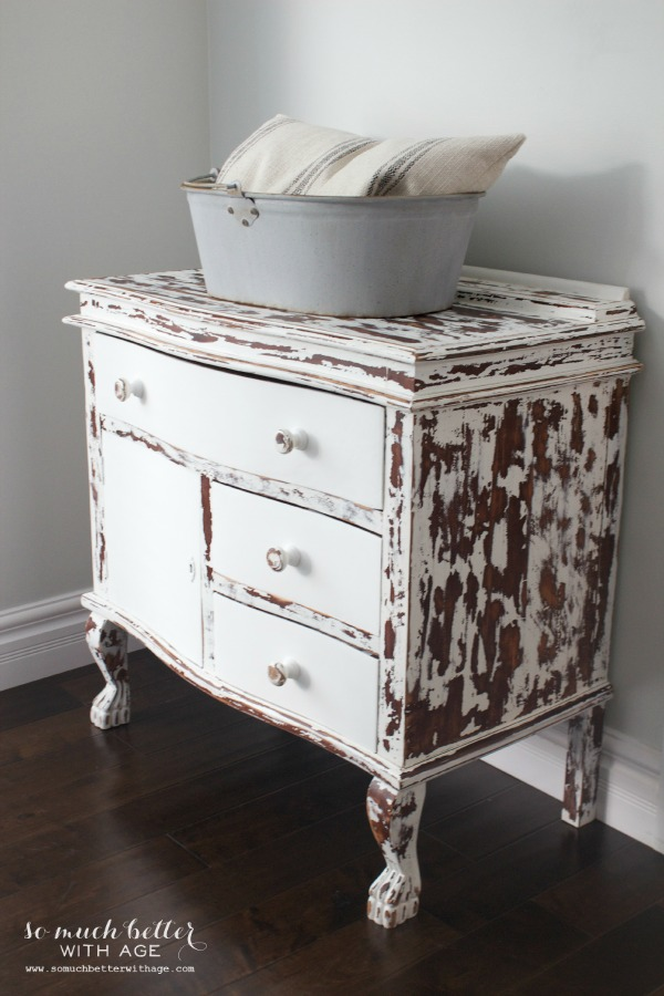 My chippy dresser resembles cowhide / white dresser on wood floor - So Much Better With Age