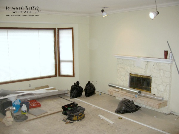 Painting the fireplace white.