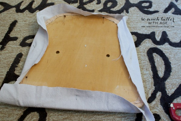 Seat upholstery using drop cloth by somuchbetterwithage.com