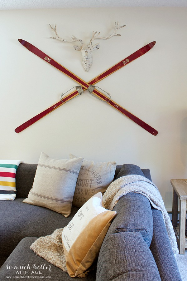 Deer head with vintage skis | somuchbetterwithage.com