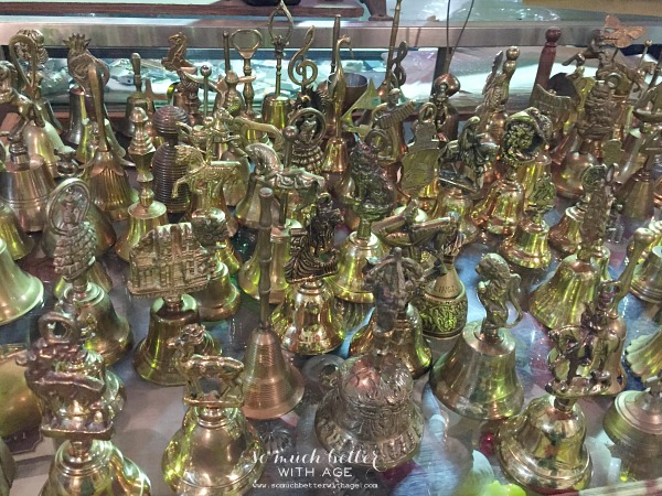 Brass figurines on a table.