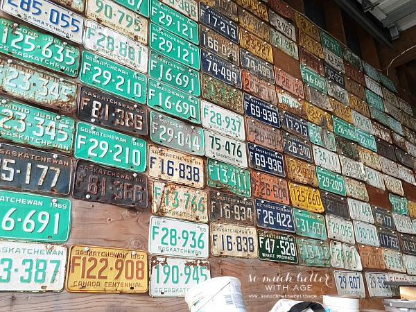 Old license plates displayed on a wall.
