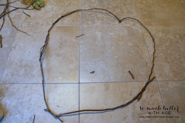 The twig heart on the floor.