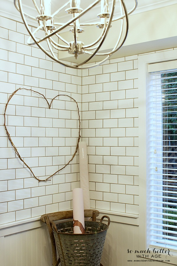 A chandelier in the kitchen beside the heart.