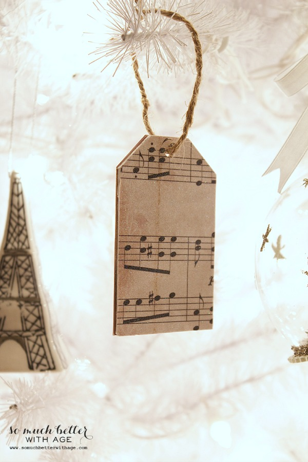 Sheet Music Wooden Tag Ornaments hanging on tree.