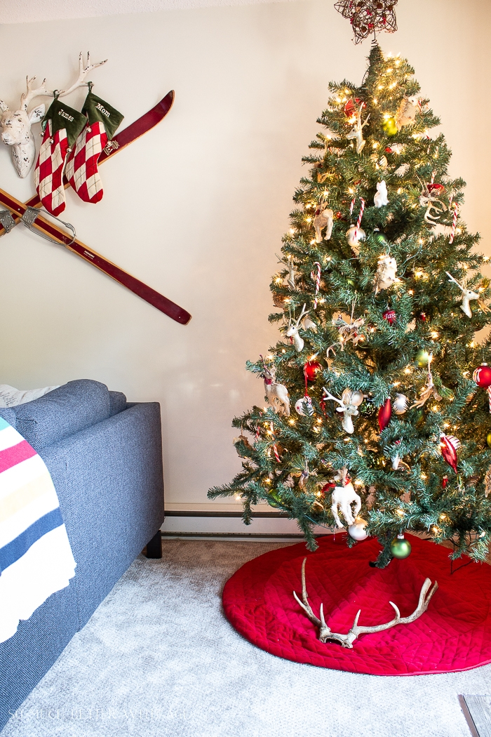 Antlers on the Christmas tree skirt in living room.