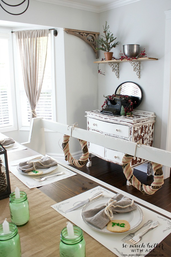 Cowhide chippy dresser behind dining room table.