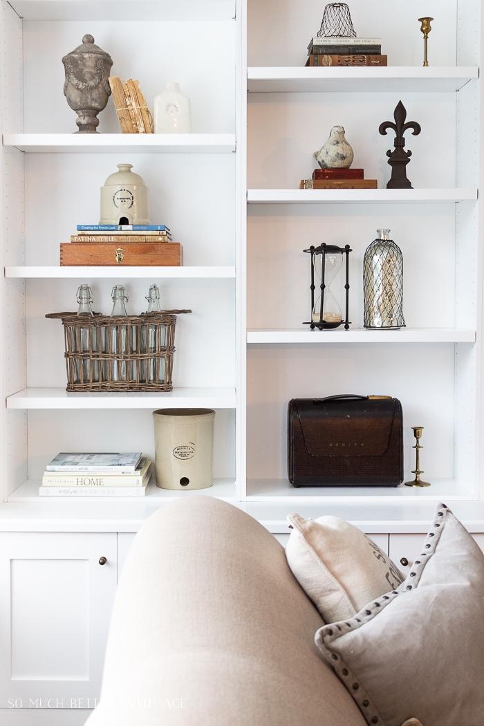 White bookshelves with knicknacks.