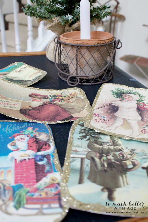DIY Vintage Glitter Christmas Postcards / postcards on table with candle - So Much Better With Age